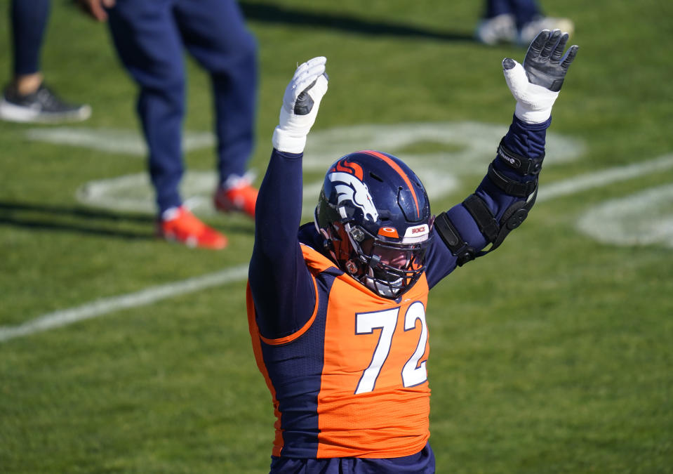 Denver Broncos offensive tackle Garett Bolles takes part in drills during an NFL football practice at the team's heasdquarters Wednesday, Nov. 25, 2020, in Englewood, Colo. (AP Photo/David Zalubowski)