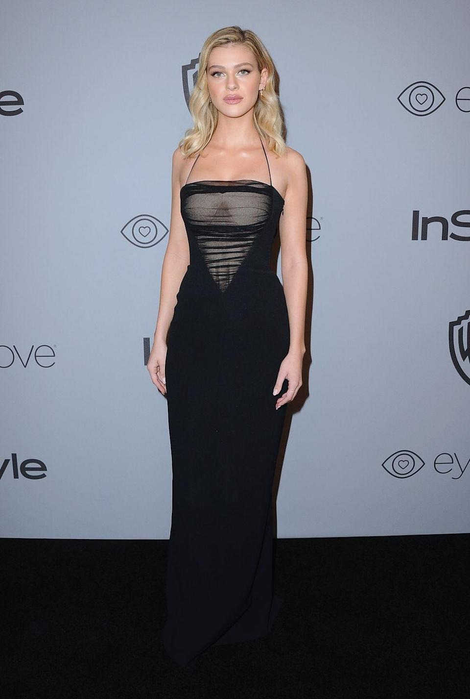 <p>The Bates Motel star wore a black column dress with sheer paneling for the after party. <br></p>