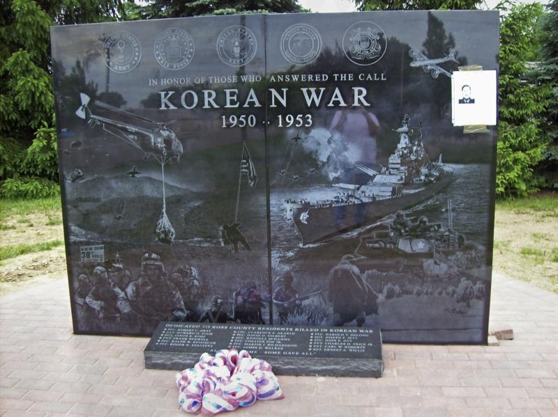A stone memorial commemorating locals who fought and died in the Korean War is seen after being unveiled at Ross County Veterans Memorial Park in Chillicothe, Ohio, in this May 28, 2014 handout provided by Tina Kutschbach. The black granite slab which was unveiled this week to honor Americans who fought and died in the Korean War has drawn calls for it to be replaced because of glaring omissions and historical inaccuracies including images from the Vietnam War and Desert Storm. REUTERS/Tina Kutschbach/Handout via Reuters (UNITED STATES - Tags: MILITARY SOCIETY)  ATTENTION EDITORS - THIS PICTURE WAS PROVIDED BY A THIRD PARTY. REUTERS IS UNABLE TO INDEPENDENTLY VERIFY THE AUTHENTICITY, CONTENT, LOCATION OR DATE OF THIS IMAGE. FOR EDITORIAL USE ONLY. NOT FOR SALE FOR MARKETING OR ADVERTISING CAMPAIGNS. THIS PICTURE IS DISTRIBUTED EXACTLY AS RECEIVED BY REUTERS, AS A SERVICE TO CLIENTS. NO SALES. NO ARCHIVES