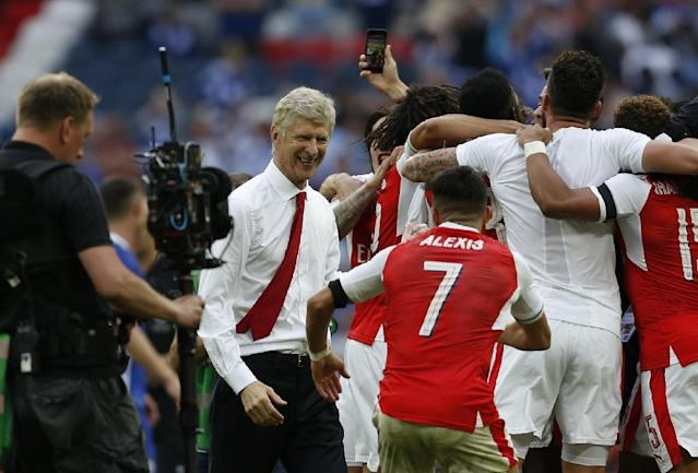 Arsenal's victory in the FA Cup final was rich vindication for French manager Arsene Wenger (2L), whose future is due to be decided at the team's board meeting in the coming days (AFP Photo/Ian KINGTON)
