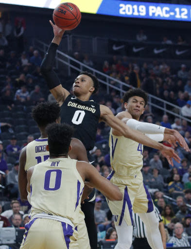 Colorado's Shane Gatling shoots against Washington during the first half of an NCAA college basketball game in the semifinals of the Pac-12 men's tournament Friday, March 15, 2019, in Las Vegas. (AP Photo/John Locher)