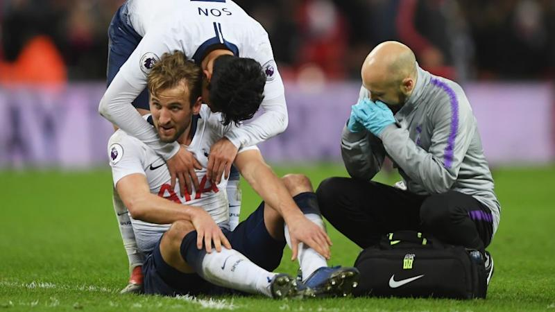 Image result for Kane had to be helped off the pitch at Wembley