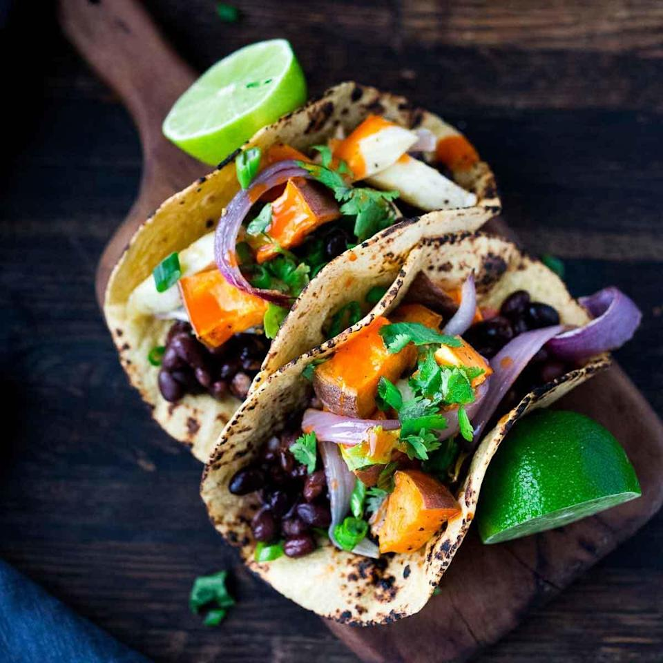 """<p>These hearty vegan tacos are quick and easy to make, perfect for busy weeknights. They are so tasty no one will miss the meat or dairy. <a href=""""http://www.eatingwell.com/recipe/257722/roasted-vegetable-black-bean-tacos/"""" rel=""""nofollow noopener"""" target=""""_blank"""" data-ylk=""""slk:View recipe"""" class=""""link rapid-noclick-resp""""> View recipe </a></p>"""