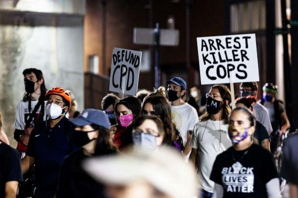 PHOTO: Protesters carried signs in support of arresting the cops that killed Breonna Taylor, Sept. 23, 2020, in Chicago. (Natasha Moustache/Getty Images)
