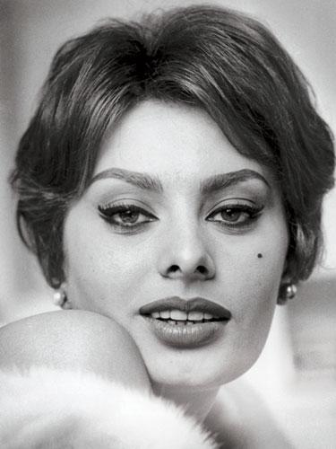 """<div class=""""caption-credit""""> Photo by: Getty Images</div><div class=""""caption-title"""">Winged liner</div>Get Sophia Loren's cat-eyes: <br> <br> 1. The easiest way to get that crisp, delicate flick is with a felt-tip eyeliner pen. (They have the same staying power as liquid formulas that come with a separate brush, but they're way easier to maneuver). To steady your drawing hand, rest your elbow on a surface, or hold it with your other hand. <br> <br> 2. Place the tip of the pen at your innermost lash. Keeping it right at your lashes, draw it along your lash line in one continuous swoop, making the line slightly thicker toward the end. <br> <br> 3. Flick the line up just a smidge past the outer corner, which creates a subtle life that makes your eyes seem bigger. <br> <br> <b>More from REDBOOK:</b> <ul>  <li>  <a rel=""""nofollow"""" href=""""http://www.redbookmag.com/beauty-fashion/tips-advice/best-at-home-hair-color?link=rel&dom=yah_life&src=syn&con=blog_redbook&mag=rbk""""><b>The Best Hairstyles for Your Age</b></a>  </li>  <li>  <a rel=""""nofollow"""" href=""""http://www.%3C/body""""></a>  <br>  </li> </ul>"""