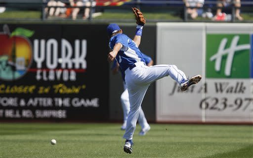 Kansas City Royals second baseman Chris Getz misses making the catch on a bloop double by San Francisco Giants' Nate Schierholtz during the first inning of a spring training baseball game Monday, March 12, 2012, in Surprise, Ariz. (AP Photo/Lenny Ignelzi)