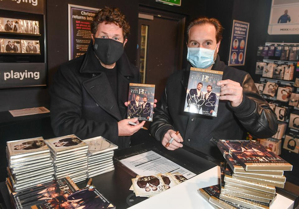 Michael Ball and Alfie Boe signing copies of their new album