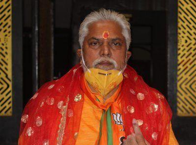 BJP candidate Prem Kumar at the polling booth.