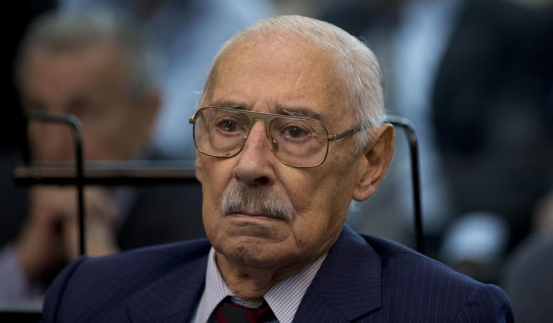 Former dictator Jorge Rafael Videla attends the first day of the trial for his alleged involvement in the so called operation, Plan Condor, in Buenos Aires, Argentina, Tuesday, March 5, 2013. Argentina began today its first human rights trial focused on the joint operation by the southern cone's 1970s dictatorships to track down leftists in each other's countries. Videla has already been sentenced to life imprisonment for crimes against humanity. (AP Photo/Natacha Pisarenko)