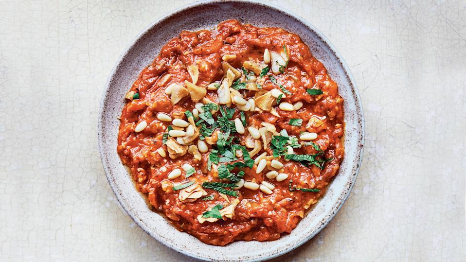 """This is somewhere between a tomato dip and stewed tomatoes. Either way, it's rich, silky, and really versatile,"" writes Sami Tamimi and Tara Wigley in <a href=""https://www.amazon.com/Falastin-Cookbook-Sami-Tamimi/dp/0399581731"" rel=""nofollow noopener"" target=""_blank"" data-ylk=""slk:Falastin"" class=""link rapid-noclick-resp""><em>Falastin</em></a><em>,</em> a vibrant collection of Palestinian recipes and stories. ""Serve these sautéed tomatoes either as part of a mezzeh, with some crusty white bread to mop it all up, or as a side to myriad dishes. Any grilled meat or fish, some pan-fried tofu, and all sorts of grain and pulse dishes work well. It's also really delicious as a pasta sauce."" <a href=""https://www.bonappetit.com/recipe/galayet-banadoura?mbid=synd_yahoo_rss"" rel=""nofollow noopener"" target=""_blank"" data-ylk=""slk:See recipe."" class=""link rapid-noclick-resp"">See recipe.</a>"