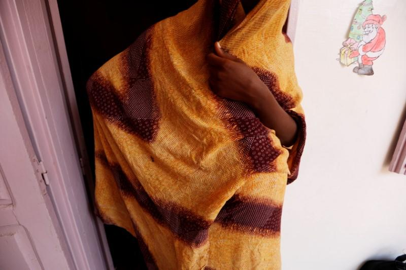 Youth who is 8 months pregnant and said she was raped by her friend is pictured at La Maison Rose in Dakar