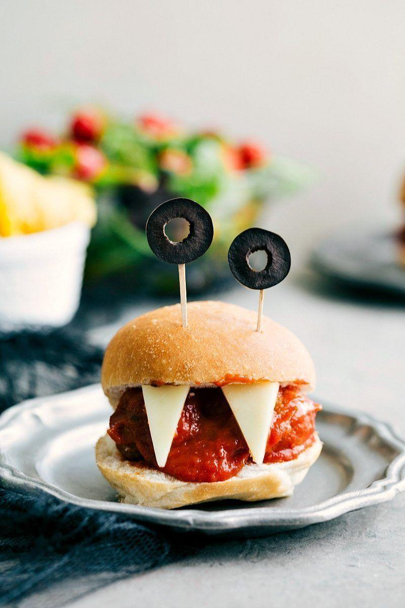 """<p>Meatball sliders are even more fun with fangs and eyeballs, and they work equally well as an appetizer or main dish.</p><p><a class=""""link rapid-noclick-resp"""" href=""""https://www.chelseasmessyapron.com/halloween-appetizers/"""" rel=""""nofollow noopener"""" target=""""_blank"""" data-ylk=""""slk:GET THE RECIPE"""">GET THE RECIPE</a></p>"""