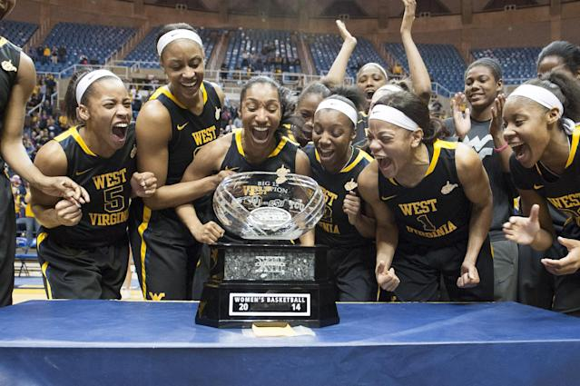 West Virginia's women's basketball team celebrates a share of the Big 12 Conference championship after defeating Kansas during an NCAA college basketball game Tuesday, March 4, 2014, in Morgantown, W.Va. West Virginia won 67-60. (AP Photo/Andrew Ferguson)