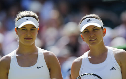 Eugenie Bouchard of Canada, left, and her opponent Simona Halep of Romania pose for photographs just prior to their women's singles semifinal match at the All England Lawn Tennis Championships in Wimbledon, London, Thursday, July 3, 2014. (AP Photo/Ben Curtis)