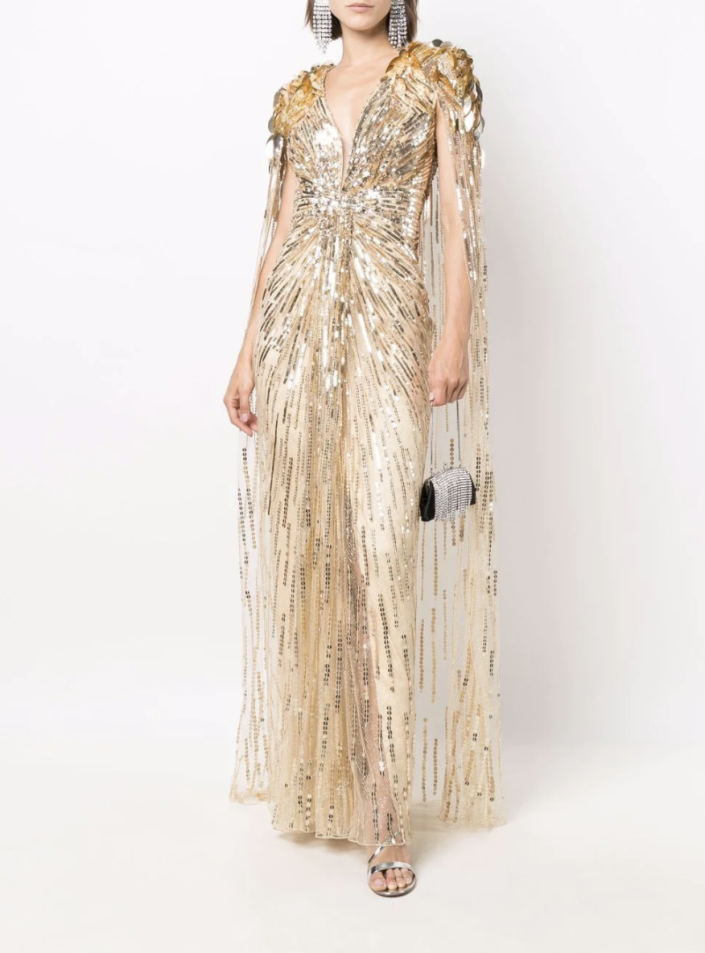 Jenny Packham's Goldfinger Sequin Cape Dress is now available for purchase.  (Farfetch)