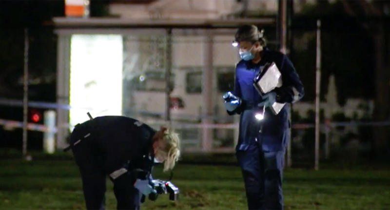 Police investigate the scene at Thornbury's Mayer Park where a woman was sexually assaulted.