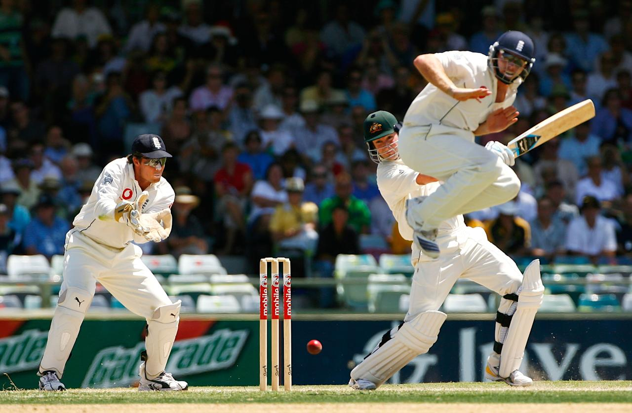 PERTH, AUSTRALIA - DECEMBER 16:  Ian Bell of England takes evasive action as Michael Clarke of Australia square cuts a delivery from Monty Panesar of England during day three of the third Ashes Test Match between Australia and England at the WACA on December 16, 2006 in Perth, Australia.  (Photo by Tom Shaw/Getty Images)