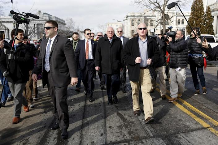 <p>Democratic presidential candidate Bernie Sanders walks along a street near a polling place in Concord, N.H., on Feb. 9, 2016. <i>(Photo: Shannon Stapleton/Reuters)</i></p>