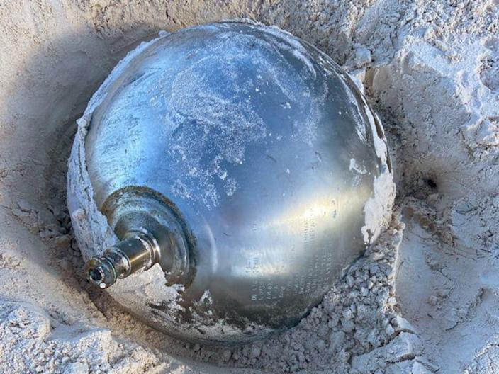 <p>Manon Clarke spotted the 41kg reflective ball poking out of the sand while walking with her family at Harbour Island</p> (Manon Clarke)