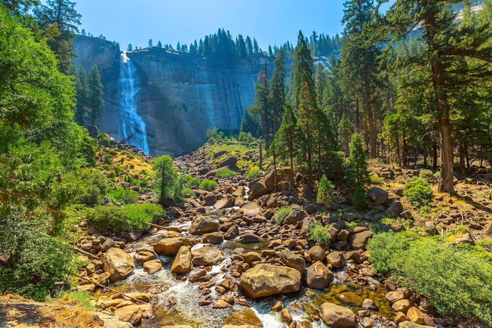 """<a href=""""https://www.cntraveler.com/story/you-can-practically-have-yosemite-national-park-to-yourself-this-fall?mbid=synd_yahoo_rss"""" rel=""""nofollow noopener"""" target=""""_blank"""" data-ylk=""""slk:Yosemite Valley might be accessible by car year round"""" class=""""link rapid-noclick-resp"""">Yosemite Valley might be accessible by car year round</a>, but the park's High Sierra region is only open through November—and temps usually hover in the 50s and 60s (ideal for fall hiking) in autumn. Mist Trail isn't easy, as it's a steep uphill trek, but it provides striking up-close views of both Vernal and Nevada Falls, and easy access to the giant sequoias of Merced and Tuolumne Groves."""