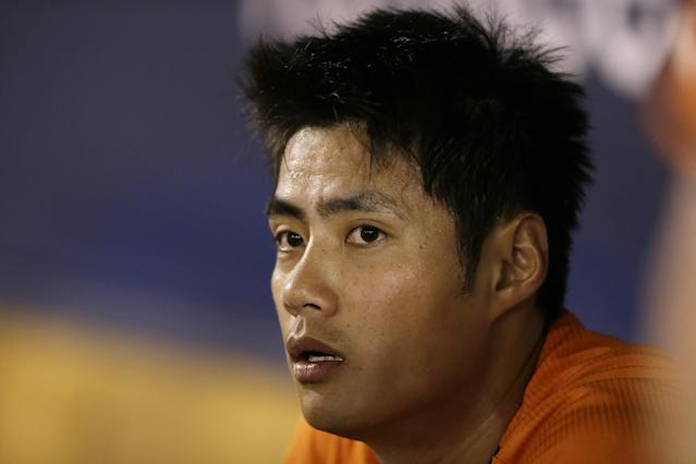 Baltimore Orioles starting pitcher Wei-Yin Chen sits in the dugout during the first inning of an exhibition baseball game against the New York Yankees Tuesday, March 4, 2014, in Tampa, Fla. (AP Photo/Charlie Neibergall)