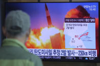 """A man watches a TV screen showing a file image of North Korea's missile launch during a news program at the Seoul Railway Station in Seoul, South Korea, Sunday, March 29, 2020. North Korea on Sunday fired two suspected ballistic missiles into the sea, South Korea said, calling it """"very inappropriate"""" at a time when the world is battling the coronavirus pandemic. The Korean letters read: """" North Korea launched two suspected ballistic missiles into the sea."""" (AP Photo/Ahn Young-joon)"""