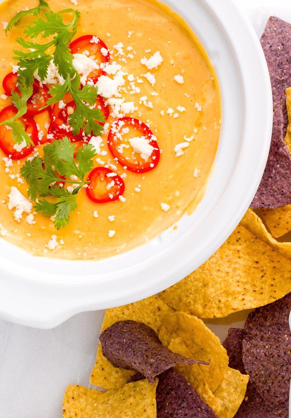 """<p>Fact: Ain't no party until queso arrives. Texan purists might hate on this shortcut queso, but you—and your hungry guests—will only love it.</p><p>Get the recipe from <a href=""""https://www.delish.com/cooking/recipe-ideas/recipes/a44677/slow-cooker-queso-recipe/"""" rel=""""nofollow noopener"""" target=""""_blank"""" data-ylk=""""slk:Delish"""" class=""""link rapid-noclick-resp"""">Delish</a>.</p>"""