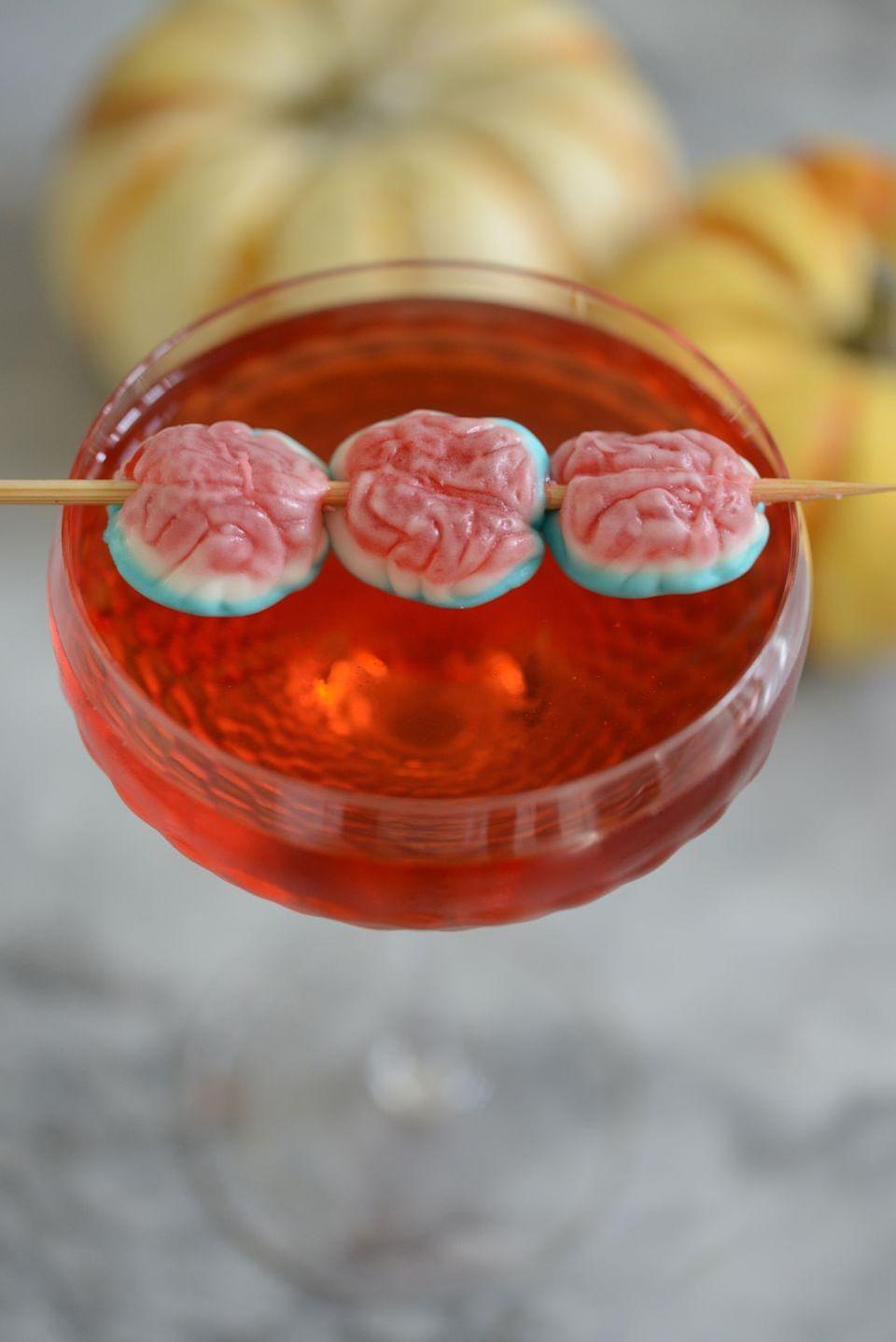 "<p>Up the creep factor of almost any cocktail by adding gummy brain garnishes.</p><p><em><a href=""http://cupcakesandcashmere.com/series-stories/halloween-cocktails"" rel=""nofollow noopener"" target=""_blank"" data-ylk=""slk:Get the recipe from Cupcakes and Cashmere »"" class=""link rapid-noclick-resp"">Get the recipe from Cupcakes and Cashmere »</a></em></p>"