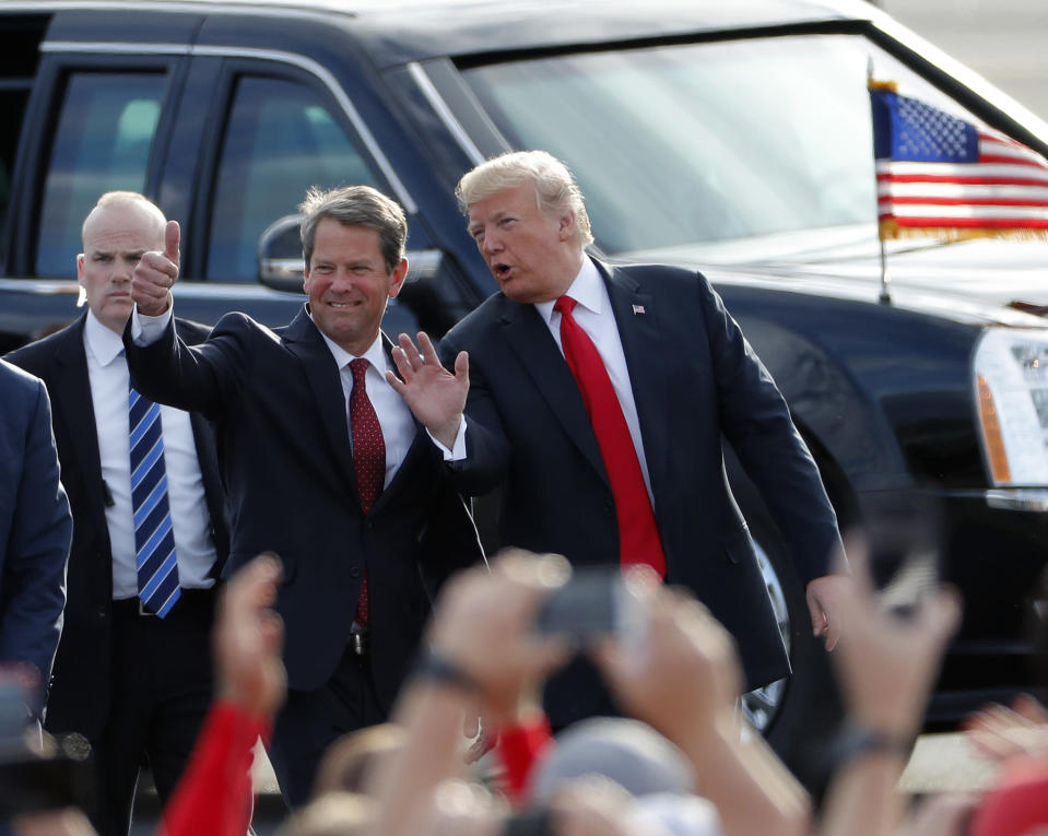 "FILE - In this Nov. 4, 2018, file photo, then-Georgia Republican gubernatorial candidate Brian Kemp, left, walks with President Donald Trump as Trump arrives for a rally in Macon , Ga. President Trump said Sunday, Nov. 29, 2020 he was ""ashamed"" for endorsing the Republican governor of Georgia after he lost in the state to Democrat Joe Biden. Trump said on Fox News that Gov. Brian Kemp has ""done absolutely nothing"" to question the state's results.. (AP Photo/John Bazemore, File)"