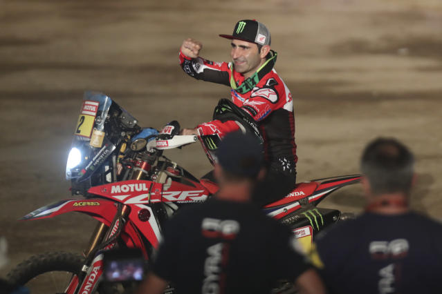 FILE - In this Sunday, Jan. 6, 2019 file photo, Paulo Gonalves of Portugal rides his Honda motorbike during the podium ceremony before the start of the Dakar Rally in Lima, Peru. Gonalves died in Saudi Arabia on Sunday Jan. 12, 2020 while taking part in his 13th Dakar rally (AP Photo/Martin Mejia, File)