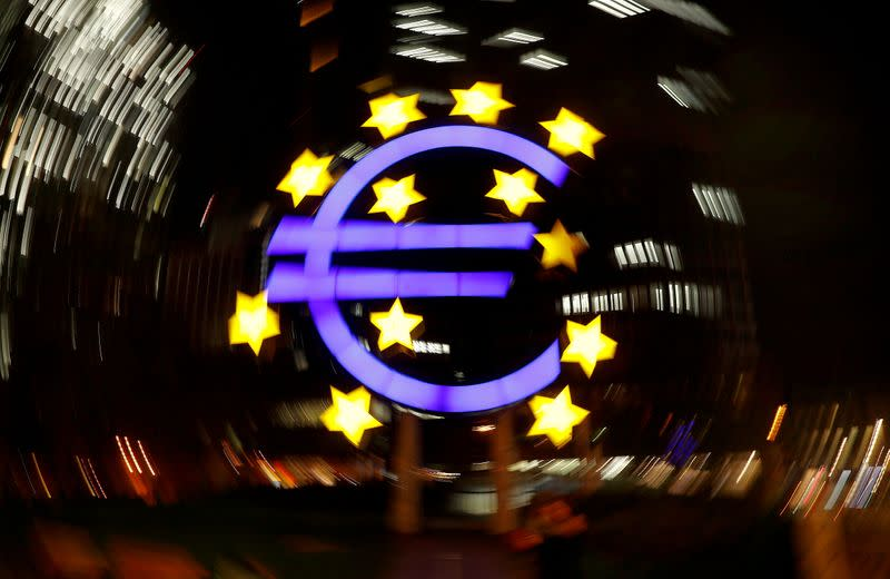 FILE PHOTO: The euro sign is photographed in front of the former head quarter of the European Central Bank in Frankfurt