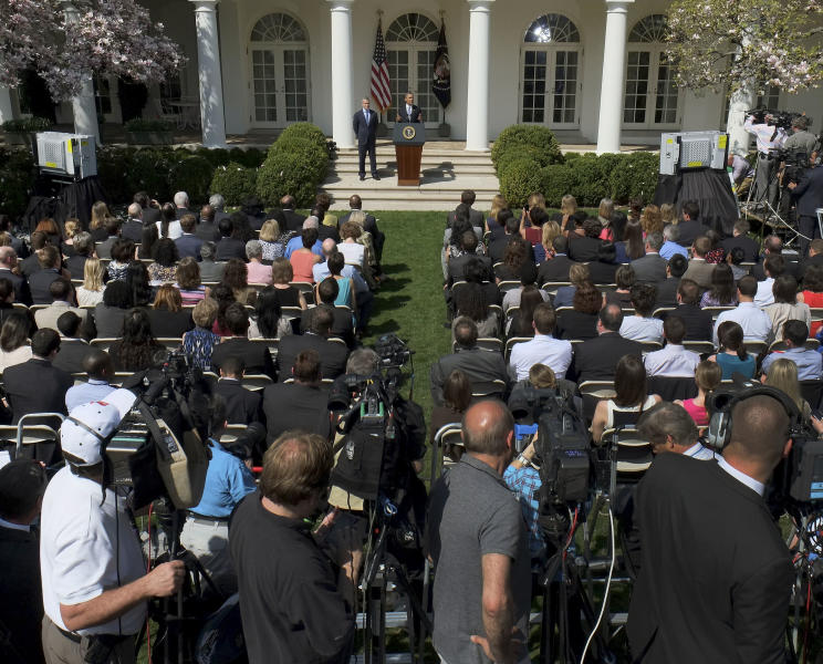 """In this photo taken April 10, 2013, President Barack Obama, top center, accompanied acting Budget Director Jeffrey Zients speaks in the Rose Garden at the White House in Washington to discuss his proposed federal budget. Presidents like to take credit for economic recoveries, just as Obama is angling to do now. He and his allies in Congress have """"walked the economy back from the brink,"""" his new 2014 federal budget blueprint asserts. And Democrats hope these improvements, while still slow and uneven, will give them at least a small boost in 2014's midterm races. (AP Photo/J. David Ake)"""