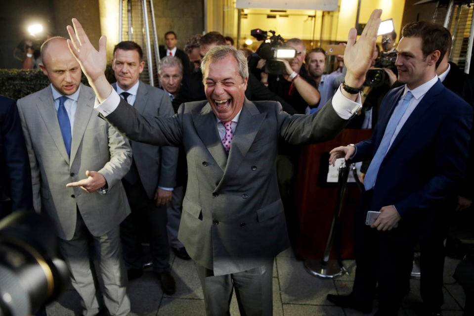FILE - In this Friday, June 24, 2016 file photo, Nigel Farage, the leader of the UK Independence Party, celebrates after Britain voted to leave the European Union. Britain will finally leave the EU on Jan. 31, 2020 after 47 years of membership. Britain and the European Union have struck a provisional free-trade agreement that should avert New Year's chaos for cross-border commerce and bring a measure of certainty to businesses after years of Brexit turmoil. The breakthrough on Thursday, Dec. 24, 2020 came after months of tense and often testy negotiations that whittled differences down to three key issues: fair-competition rules, mechanisms for resolving future disputes and fishing rights. (AP Photo/Matt Dunham, File)