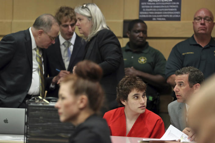 School shooting suspect Nikolas Cruz, center, speaks with attorney Gabe Ermine as members of his defense team, from left; David Frankel, Joseph Burke and Diane Cuddihy, confer behind him before a hearing at the Broward Courthouse in Fort Lauderdale, Fla., Tuesday, May 28, 2019. (Amy Beth Bennett/South Florida Sun Sentinel via AP, Pool)