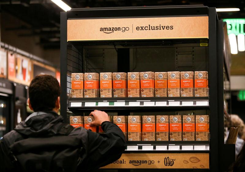 FILE PHOTO: A customer selects an Amazon Go-branded Theo chocolate bar in the new Amazon Go store in Seattle