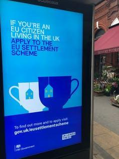 An advertisement at a bus stop urging EU citizens living in the UK to apply for the settlement scheme.