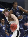 <p>Old Dominion's Dajour Dickens (23) and Purdue's Matt Haarms compete for a rebound during the second half of a first-round game in the NCAA men's college basketball tournament Thursday, March 21, 2019, in Hartford, Conn. Purdue won 61-48. (AP Photo/Elise Amendola) </p>