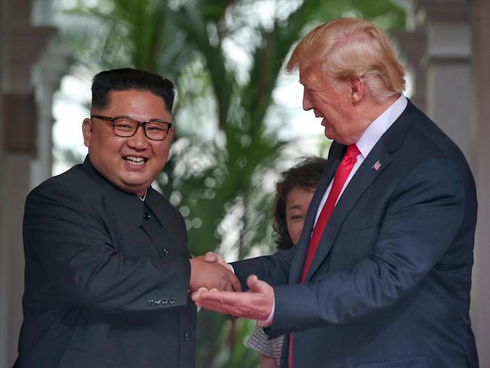 North Korean leader Kim Jong-un shakes hands with US President Donald Trump during their historic US-DPRK summit: Getty