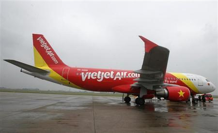 A VietJet A320 airplane is seen while parking before departure for Bangkok, at Noi Bai international airport in Hanoi