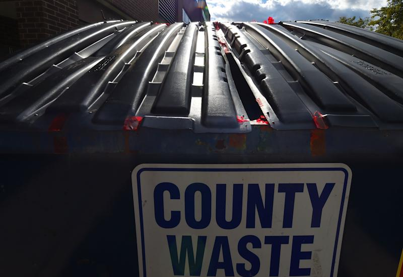 Evidence tape remains on a county waste dumpster outside of the elections board of Luzerne County. A small group of citizens protest outside of Penn Place where the Luzerne County Elections board is located after an investigation into military ballots found in the trash. (Aimee Dilger/SOPA Images/LightRocket via Getty Images)
