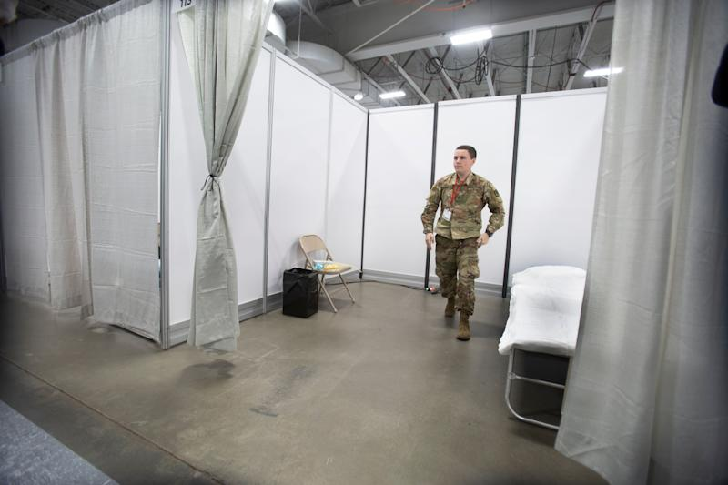 Workers make preparations at an emergency field hospital to help New Jersey respond to a huge swell in COVID-19 cases in Secaucus on April 2, 2020. (Photo: Getty Images)