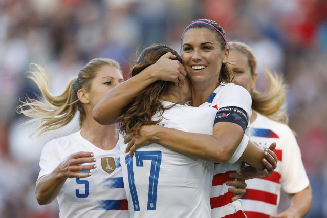 FILE - In this July 26, 2018, file photo, U.S. forward Alex Morgan, second from right, celebrates her hat trick with defender Tobin Heath (17) and other teammates during the second half of a Tournament of Nations soccer match against Japan in Kansas City, Kan. The Women's World Cup kicks off Friday, June 7, 2019, in Paris. Twenty-four teams will traverse France for the next month in pursuit of soccer's most prestigious trophy. (AP Photo/Colin E. Braley, File)