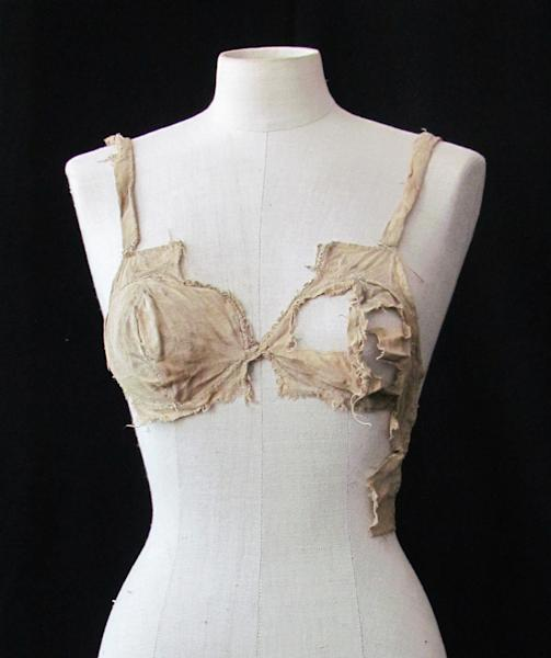 This undated picture publicly provided by the Archeological Institute of the University of Innsbruck, shows a medieval bra. The bra is commonly thought to be little more than 100 years old as corseted women abandoned rigid fashions and opted for the more natural look. But that timeline is about to be revised with the discovery of four brassieres from the Middle Ages in a debris-filled vault of an Austrian castle. The find, formally announced Wednesday July 18, 2012 by the University of Innsbruck, is being described by historical fashion experts as revolutionary because it indicates that the bra was already worn around 600 years ago before being abandoned for the stiff stays dictated by the form-hugging clothing that become the mode for centuries. (AP Photo/University Innsbruck Archeological Institute)