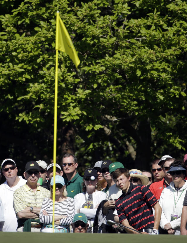 Matthew Fitzpatrick, of England, hits to the first green during the first round of the Masters golf tournament Thursday, April 10, 2014, in Augusta, Ga. (AP Photo/Darron Cummings)