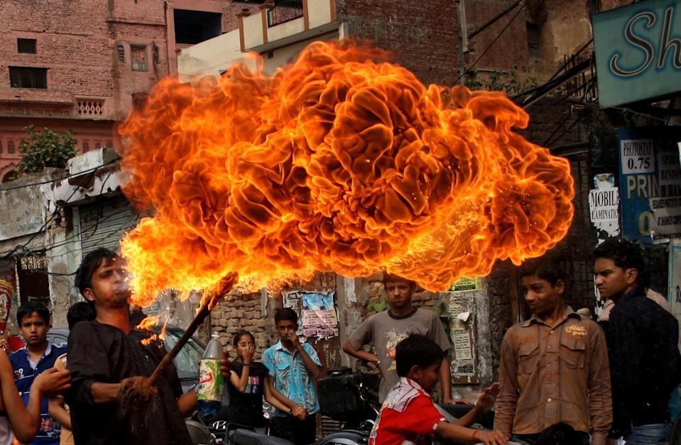 Blowing fire<br><br>During the festival of Ram Navami that celebrates the birthday of the hindu god, devotees blow fire out of their mouths. Some of them dance and do circus tricks while blowing fire.