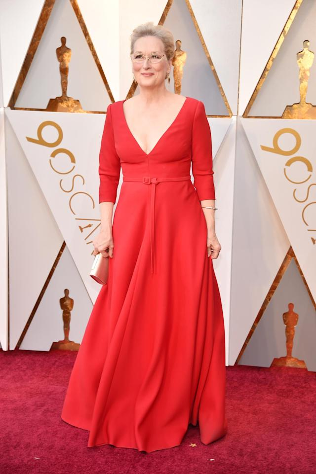 <p>Meryl Streep's red Dior gown was pretty simple — but was a stand out thanks to the color and the plunging neckline. (Photo by Kevin Mazur/WireImage) </p>