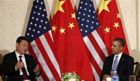 China's President Xi speaks during his meeting with U.S. President Obama, on the sidelines of a nuclear security summit, in The Hague