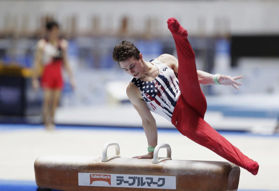 Paul Juda of the U.S. competes in the pommel horse during an international gymnastics meet in Tokyo on Sunday, Nov. 8, 2020. Gymnasts from four countries of China, Russia, U.S. and Japan performed in the meet at Yoyogi National Stadium First Gymnasium, a venue planned to be used in the Tokyo 2020 Olympics in the summer 2021. (AP Photo/Hiro Komae)
