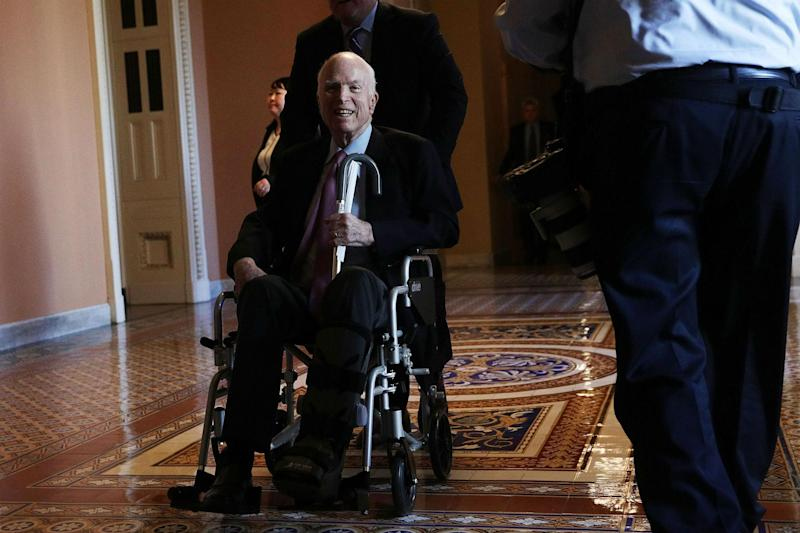 Senator John McCain passes by on a wheelchair in a hallway at the Capitol December 1, 2017 in Washington, DC.(Photo by Alex Wong/Getty Images)