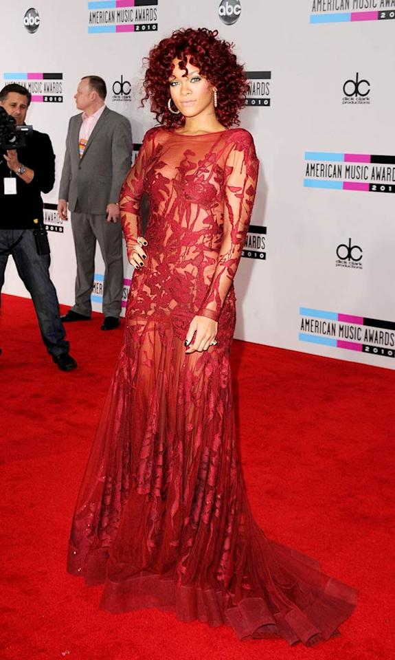 "Thankfully, Rihanna decided to tone down her Ronald McDonald red hair for the AMAs! As a result, the ""Only Girl (In the World)"" singer looked ravishing in a lace gown by Elie Saab, which perfectly matched her dark curls and showed just a hint of skin. Jason Merritt/<a href=""http://www.gettyimages.com/"" target=""new"">GettyImages.com</a> - November 21, 2010"